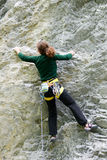 Person climbing on the rock at Engelberg Royalty Free Stock Photography