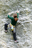 Person climbing on the rock at Engelberg Royalty Free Stock Photo