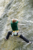 Person climbing on the rock at Engelberg Stock Photography