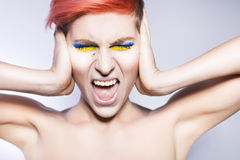 Person closing ears and don't want to listen political lies crying. Ukrainian symbols and colors Royalty Free Stock Photos