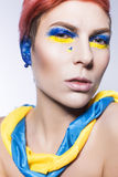 Person closing ears and don't want to listen political lies crying. Ukrainian symbols and colors Stock Photo