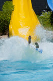Person coming down a water slide Royalty Free Stock Photography