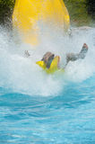 Person coming down a water slide Stock Images