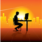 Person with computer in city. Colorful illustration of person using computer at desk, city skyline and sunset in background Stock Photo