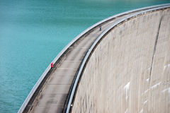 Person on concrete dam Royalty Free Stock Image