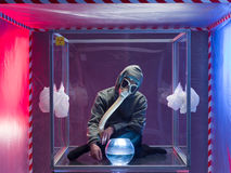 Person confined inside a glass box Royalty Free Stock Image