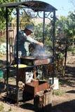 Person cooking shish kebab stock images