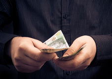 Person counting certain amount money Stock Images