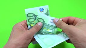 Person counting 100 euro Stock Photo