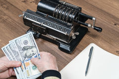 Person counting money. Hands of person counting the dollars at the table. Horizontal indoors shot Royalty Free Stock Images