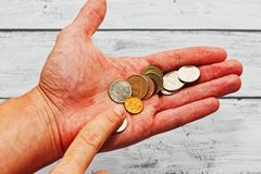 Person counting russian coins in hand royalty free stock images