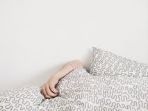 Person Covered a Grey Bed Cover Royalty Free Stock Photo
