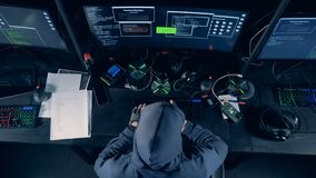 A person cracking computer. Hacker cracks system, using computer. stock footage