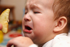 Person crying baby stock image