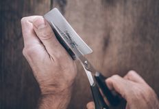 Person cutting credit card into half with scissors royalty free stock photos