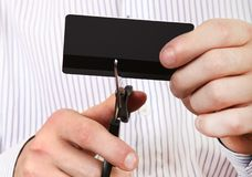 Person cutting a Credit Card. With a Scissors Closeup Royalty Free Stock Images