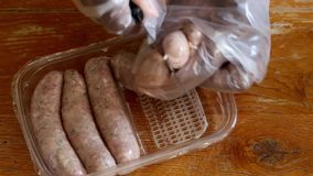 Person cutting Cumberland sausage links
