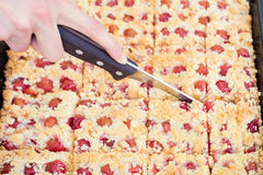 Person cutting sweet homemade crumble cherry pie Stock Photos