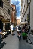 Person cycling through the pedestrian street called stock photography