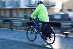 Person Cycling With Safety Clothing And Helmet
