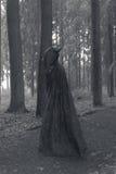 Person with dark cape Stock Photo
