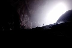Person in Dark Cave at Daytrime Royalty Free Stock Image