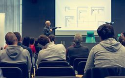 Person delivering a speach. Audience at a conference presentation Stock Photography