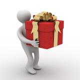 Person, die einen Geschenkkasten trägt. Stockfotografie