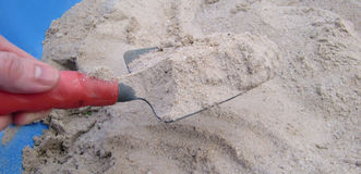 Person digging in sand Stock Photography