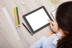 Person with digital tablet and student accessories Royalty Free Stock Photos