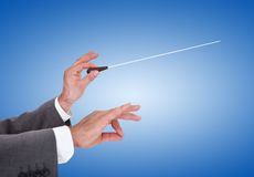 Person directing with a conductor's baton Royalty Free Stock Photos