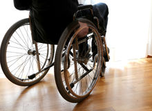Person with disability in the bedroom. With parquet floor Royalty Free Stock Image