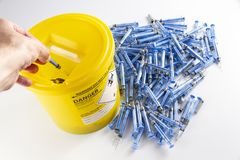 Person disposing of glatiramer acetate syringe stock photos
