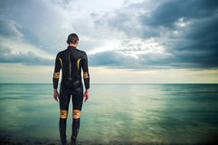 The person in a diving suit. On seacoast Stock Images