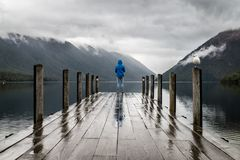 Person on dock in rain