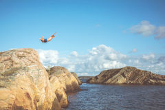 Person Doing Cliff Diving during Daytime Stock Images