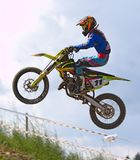 Person Doing Stunt in Motocross Dirt Bike Stock Photo