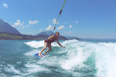 Person Doing Surfboarding on the Seat Under Daytime Royalty Free Stock Images
