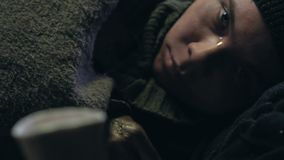 Person donating to homeless boy, street child suffering cold and diseases. Stock footage stock footage