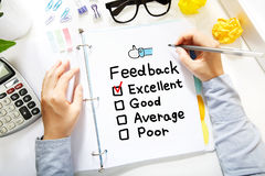 Person drawing Feedback concept on white paper Royalty Free Stock Images