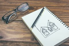 Person Drawing House Prices Growth Concept On Notepa.  stock image