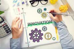 Person drawing Innovation concept on white paper Royalty Free Stock Images
