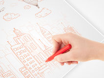 A person drawing sketch of a city with balloons and clouds  Royalty Free Stock Photo