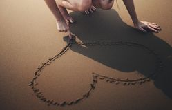 Person Draws Heart on Sand Royalty Free Stock Photos