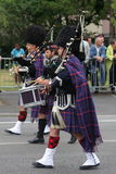 Person dressed in traditional Scottish dress marching for the national day of 14 July , France Royalty Free Stock Photo