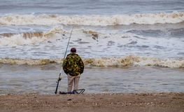 Beach fishing in winter. Royalty Free Stock Images