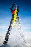 Person drilling ice in the winter Royalty Free Stock Photo