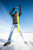 Person drilling ice in the winter Stock Image