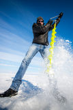 Person drilling ice in the winter Stock Images
