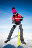Person drilling ice in the winter Royalty Free Stock Photos